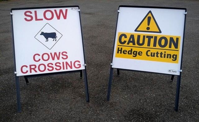 2-caution-signs-cows-crossing