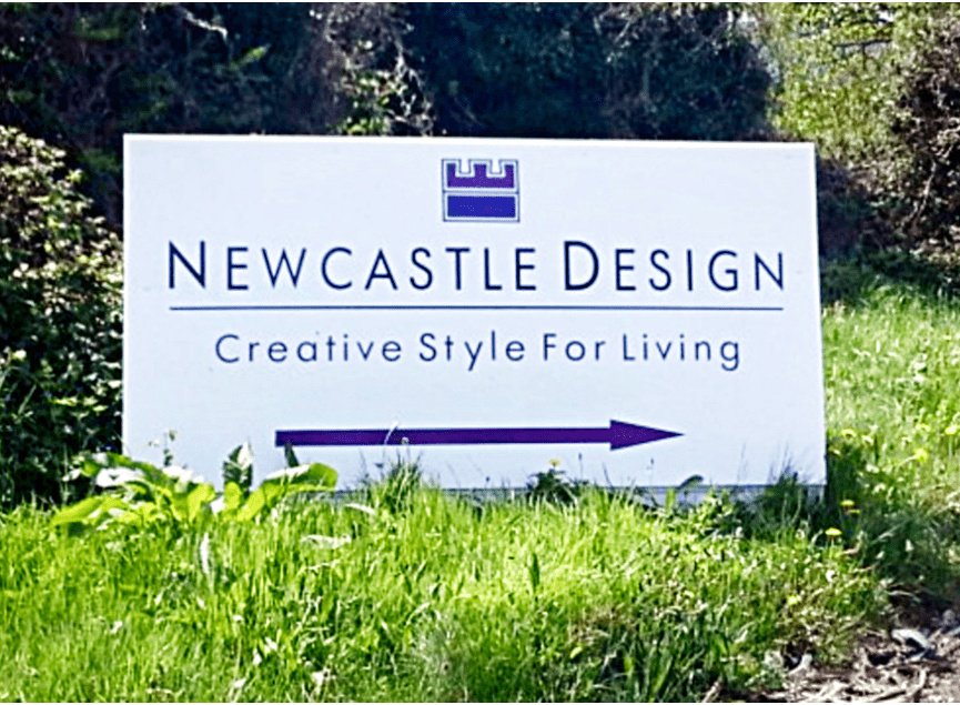 newcastle-design-sign-board-on-grass-patch