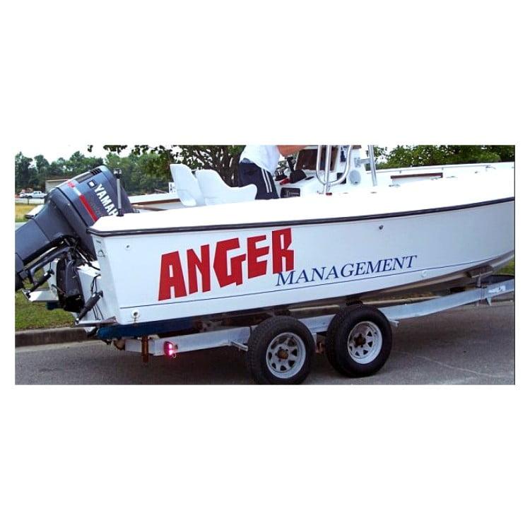 white-boat-with-yamaha engine-anger-management-boat-sign