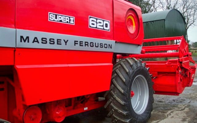 decals on a red combine harvester