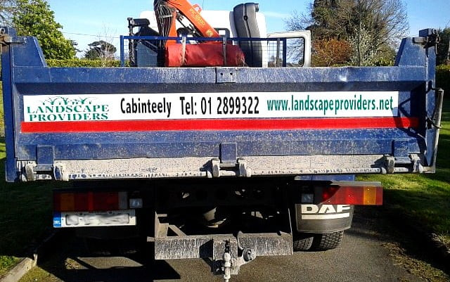 a magnetic sign applied to the back of a landscaping truck